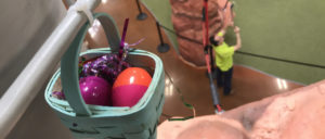 Egg Hunt Easter egg basket hanging from Summit Ropes indoor adventure ropes course obstacle.